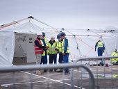 Emergency Response Team workers training in control centre tent