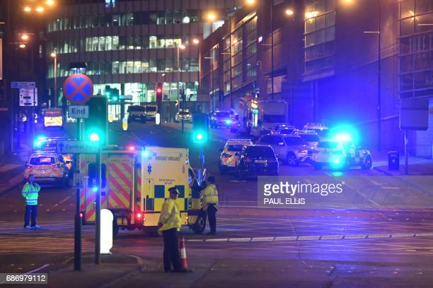 TOPSHOT Emergency response vehicles are parked at the scene of a suspected terrorist attack during a pop concert by US star Ariana Grande in...