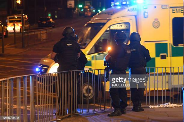 Emergency response vehicles arrive at the scene of a suspected terrorist attack during a pop concert by US star Ariana Grande in Manchester northwest...