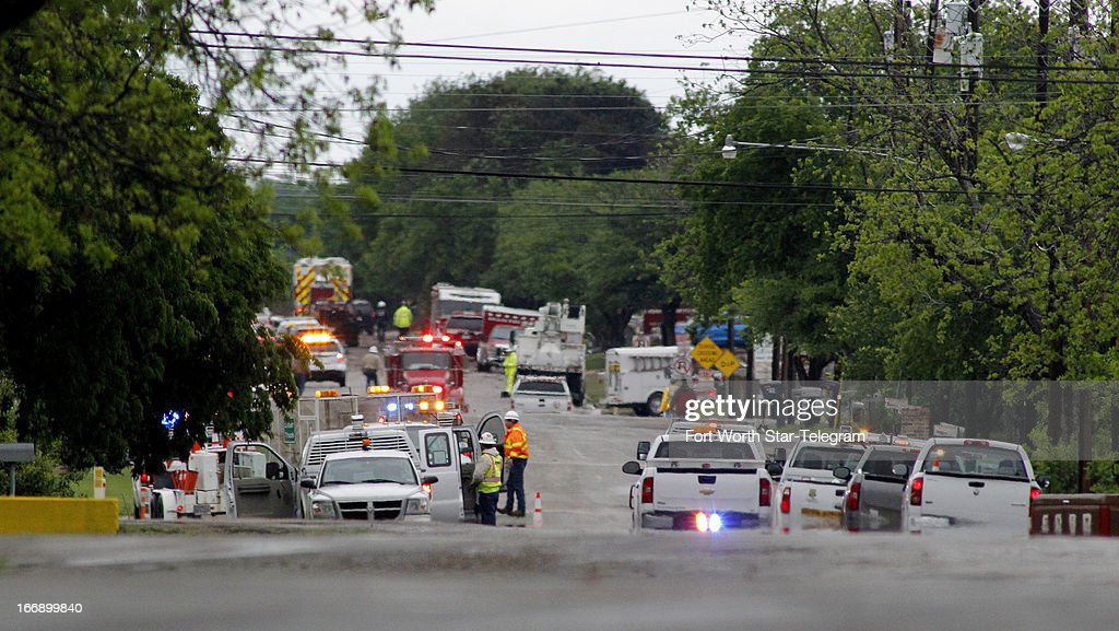 Emergency response vehicles line a road near downtown in West, Texas, on Thursday, April 18, 2013. Much of the small town suffered damage when a fertilizer plant caught fire causing a massive explosion Wednesday night. Authorities are still trying to determine the death and injury toll.