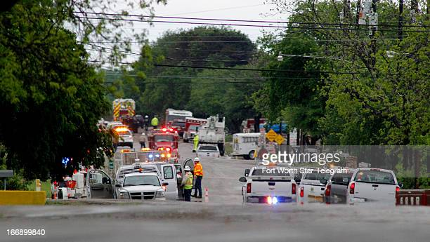 Emergency response vehicles line a road near downtown in West Texas on Thursday April 18 2013 Much of the small town suffered damage when a...