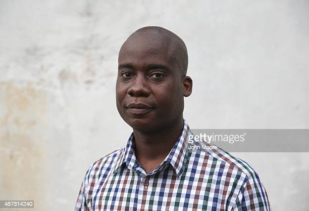 Emergency room doctor and Ebola survivor Philip Ireland stands outside the JFK Hospital where he works on October 13 2014 in Monrovia Liberia Ireland...