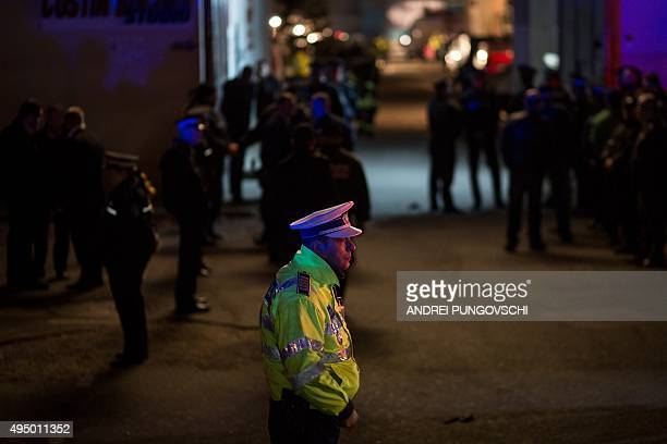 Emergency service and police forces block the area near a club in Bucharest October 31 after an explosion More than 20 people died and dozens were...