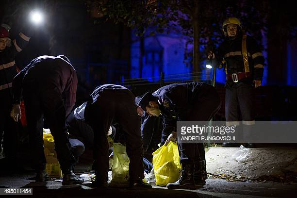 Emergency service and police forces collect evidence near a club in Bucharest October 31 after an explosion More than 20 people died and dozens were...