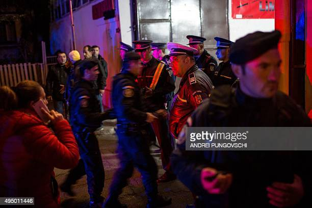 Emergency service and police forces gather near a club in Bucharest October 31 after an explosion More than 20 people died and dozens were injured in...