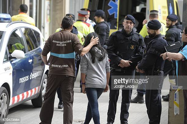Emergency service members attend students at the Joan Fuste Institue in Barcelona on April 20 2015 after a student allegedley broke into the school...