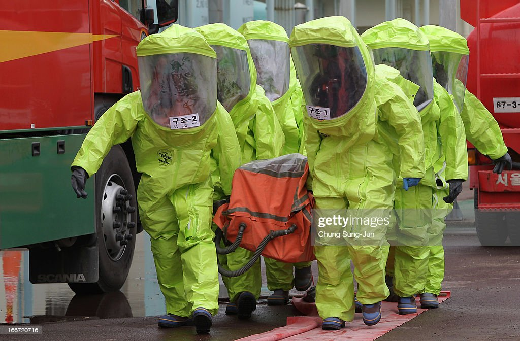 Emergency service personnel wearing chemical protective clothing participate in a chemical incident exercise on April 16, 2013 in Seoul, South Korea. Amid rising tensions between South Korea and North Korea, North Korea announced today that they will take retaliatory actions following the convergence in Seoul of around 300 South Korean activists who burnt effigies of North Korean leader Kim Jong-un and the nation's founder Kim Il-sung on the 101st anniversary of his birth.
