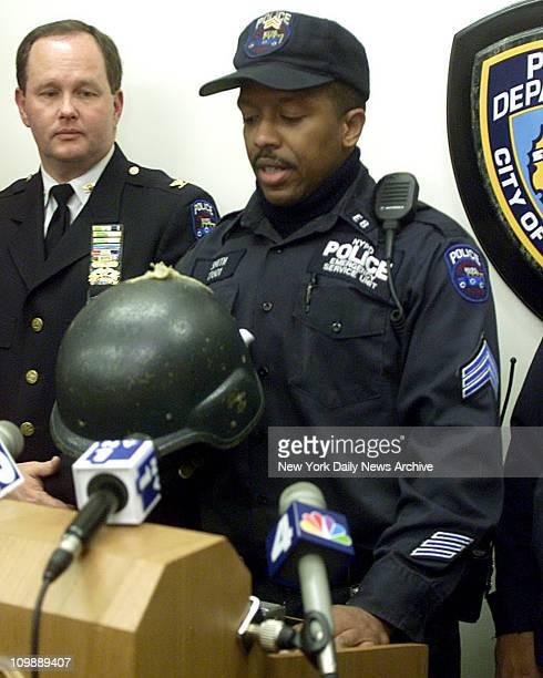 Emergency Service Unit Officer Winston Smith holds the kevlar helmut he was wearing when he was shot in the head hours before delivering a baby on...