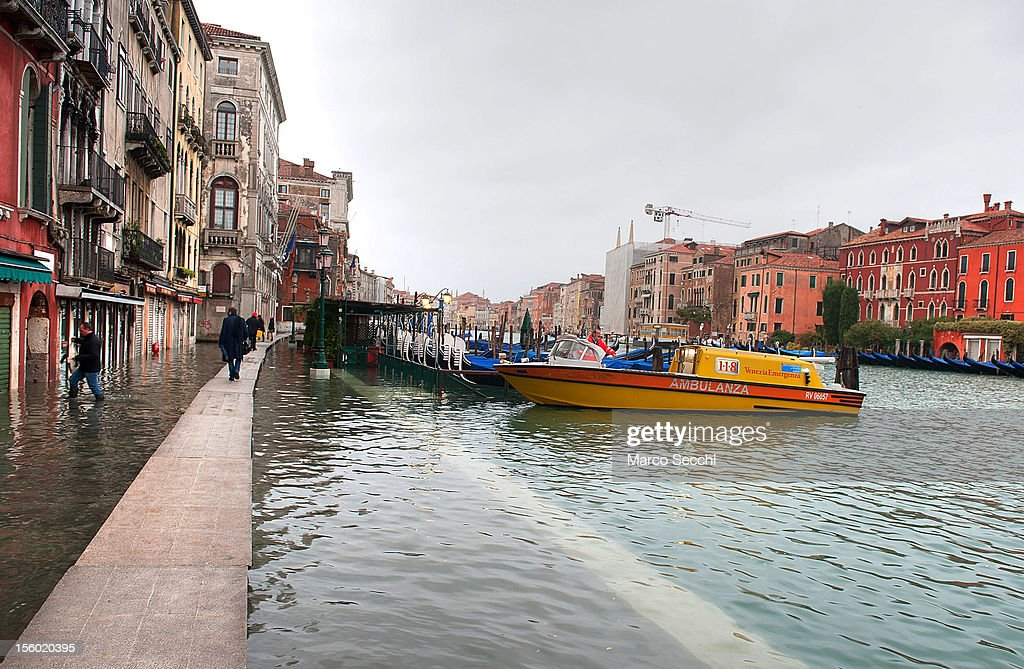 Emergency services along the Grand Canal near Rialto during the exceptional High Water on November 11, 2012 in Venice, Italy. More than 70% of Venice has been been left flooded, after the historic town was hit by exceptionally and unexpected high tide. The sea level rose very quickly to 150 due as well to strong southerly wind and heavy rain.