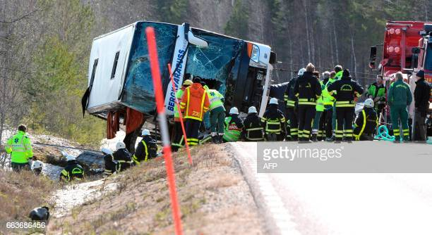 Emergency services and ambulance help at the site where a serious bus accident occurred on the E45 between Sveg and Fagelsjo in Sweden on April 2...