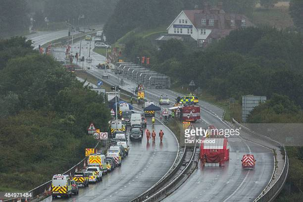 Emergency services and crash investigation officers work at the site where a Hawker Hunter fighter jet crashed on August 23 2015 in Shoreham England...