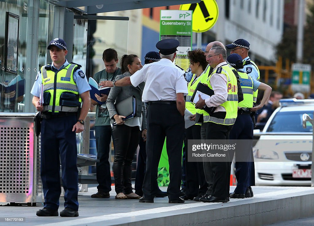 Emergency services are seen on March 28, 2013 in Melbourne, Australia. Police have confirmed two people have died and another has been seriously injured after a brick wall collapsed on Swanston street in Carlton in North Melbourne CBD.