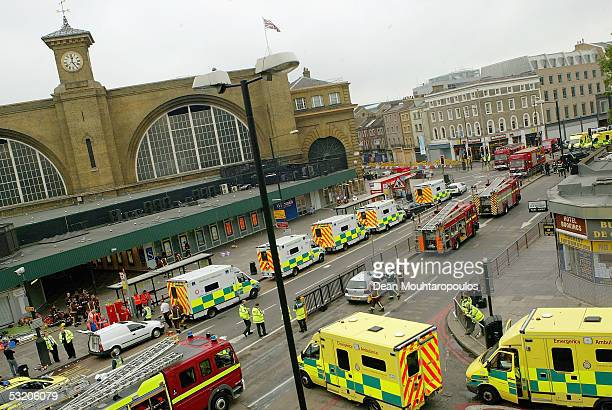 Emergency services are seen outside the main line station at Kings Cross following an explosion which has ripped through London's tube network on...
