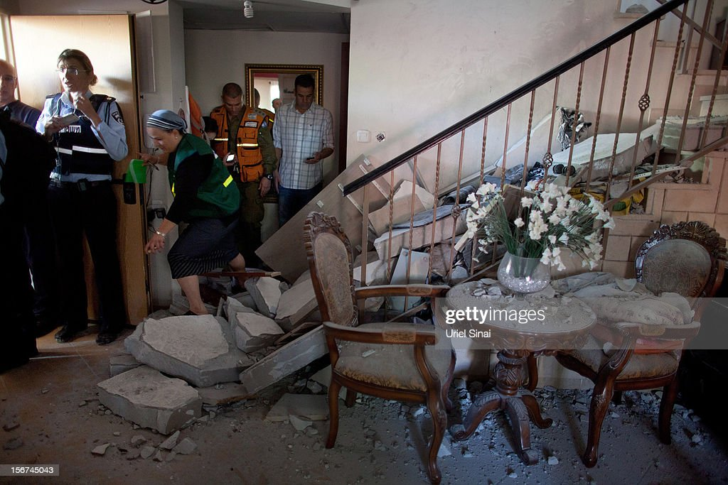 Emergency services at a house after it was hit by a rocket fired from the Gaza Strip on November 20, 2012 in Beersheba, Israel. Hamas militants and Israel are continuing talks aimed at a ceasefire as the death toll in Gaza reaches over 100 with three Israelis also having been killed by rockets fired by Palestinian militants.