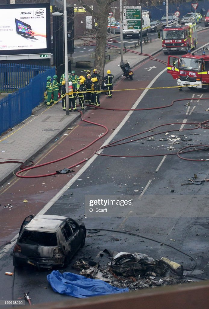 Emergency services at the scene after a helicopter reportedly collided with a crane attached to St Georges Wharf Tower in Vauxhall, on January 16, 2013 in London, England. According to reports, the helicopter hit the crane before plunging into the road below during the morning rush hour.