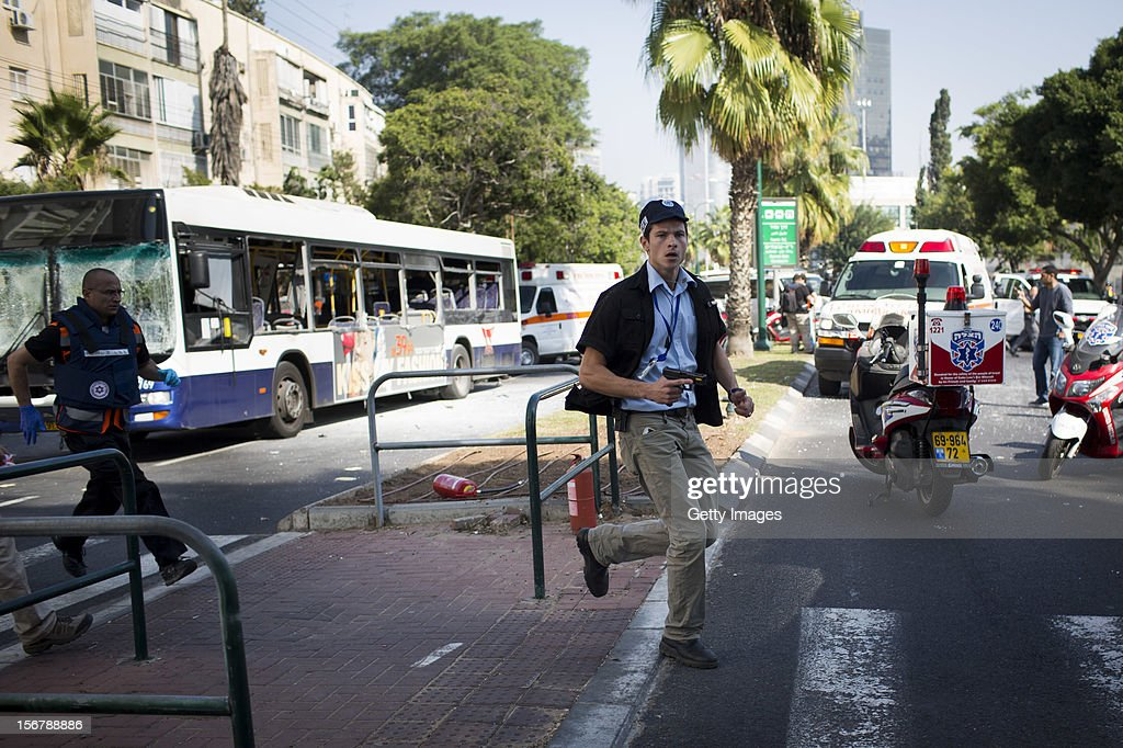 Emergency services at the scene of an explosion on a bus with passengers onboard on November 21, 2012 in central Tel Aviv, Israel. At least ten people have been injured in a blast on a bus near military headquarters in what is being described as terrorist attack which threatens to derail ongoing cease-fire negotiations between Israeli and Palestinian authorities.