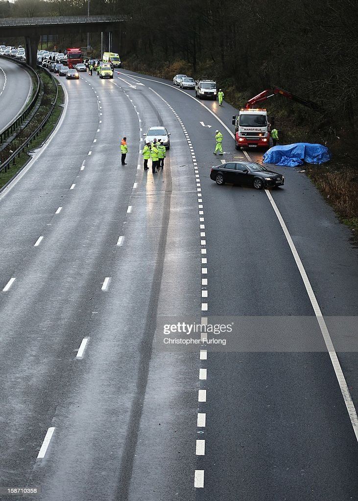 Emergency services attend the aftermath of a serious motor accident between Junctions 14 and 15 on the M6 motorway on December 25, 2012 between Stafford and Stoke-on-Trent, England. West Midlands Ambulance service are reporting that three children died in the accident and two women are left seriously injured.