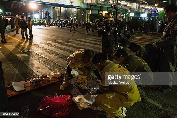 Emergency services attend the scene of an explosion on August 17 2015 in Bangkok Thailand A large explosion believed to a bomb has hit central...