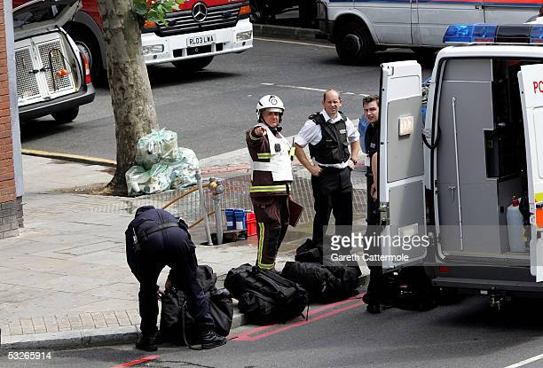 Emergency services attends the Hackney Road area in Bethnal Green on July 21 2005 in London England The windows were blown out of a nearby number 26...