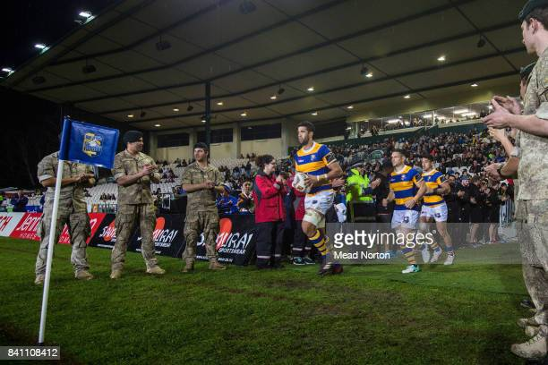 Emergency Services formed a honour guard as the BOP Steamers and Wellington Lions took the field at the round three Mitre 10 Cup match between Bay of...