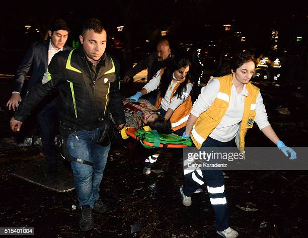 Emergency services help an injured person following after an explosion in Ankara's central Kizilay district on March 13 2016 in Ankara Turkey The...