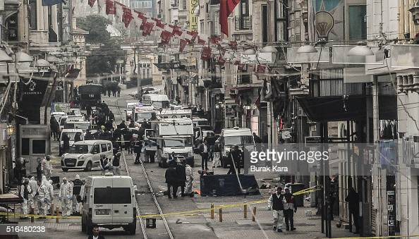 Emergency services inspect the area following a suicide bombing in a major shopping and tourist district in the central part of the city on March 19...