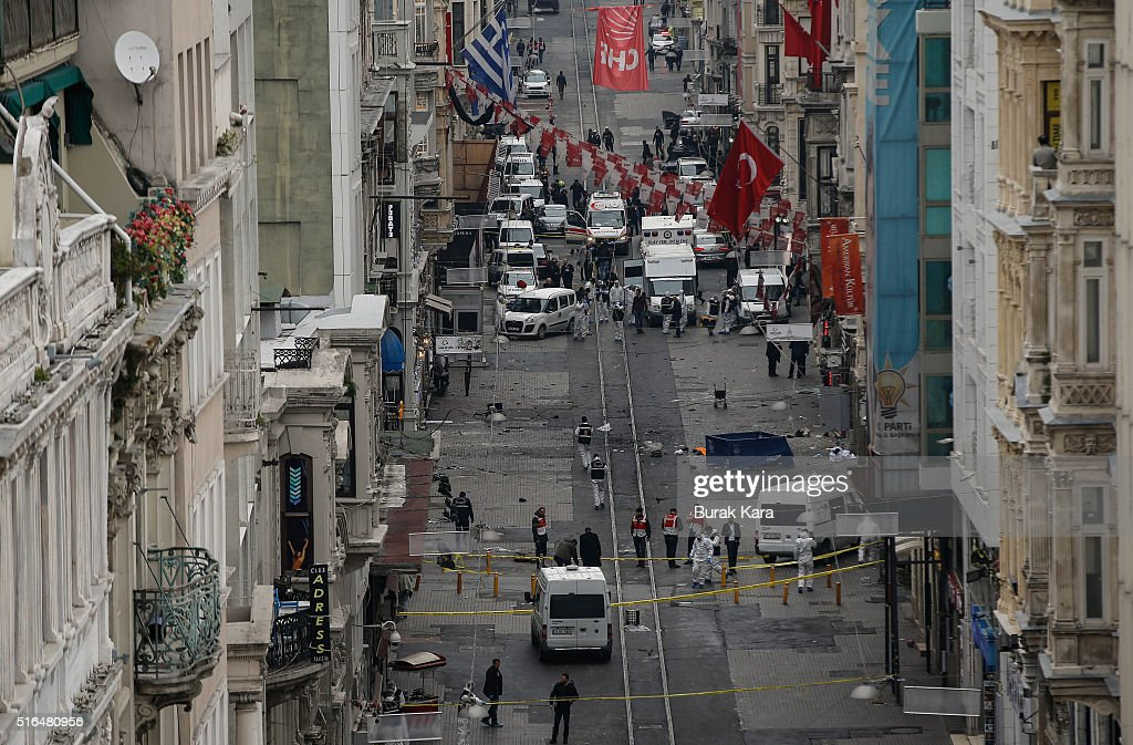 Emergency services inspect the area following a suicide bombing in a major shopping and tourist district in central Istanbul March 19 Turkey An...