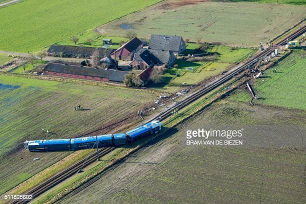 TOPSHOT Emergency services intervene on the scene of a derailed passengers train near Dalfsen eastern Netherlands on February 23 2016 A passenger...