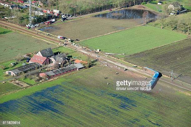 Emergency services intervene on the scene of a derailed passengers train near Dalfsen eastern Netherlands on February 23 2016 A passenger train...