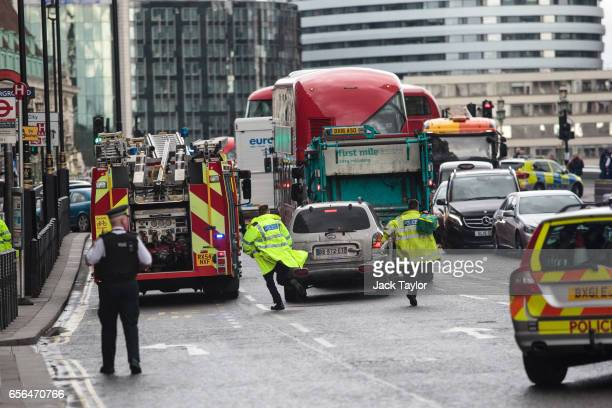 Emergency services make their way down Westminster Bridge towards the Houses of Parliament on March 22 2017 in London England A police officer has...