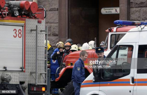 Emergency services personnel and vehicles are seen at the entrance to Technological Institute metro station in Saint Petersburg on April 3 2017...