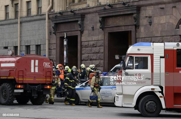 TOPSHOT Emergency services personnel walk at the entrance to Technological Institute metro station in Saint Petersburg on April 3 2017 Around 10...