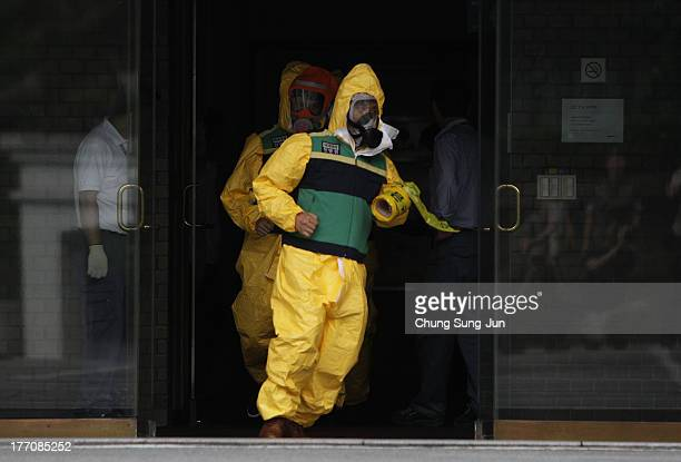 Emergency services personnel wearing protective clothing participate in an antiterror and antichemical drill session held as part of the Ulchi...