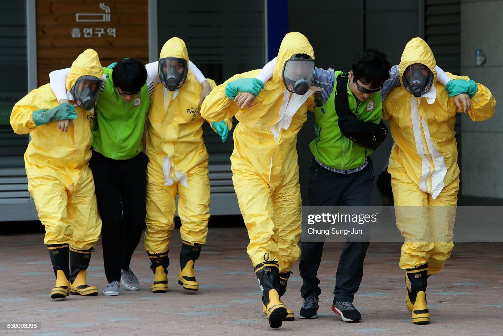 Emergency services personnel wearing protective clothing participate in an anti-terror and anti-chemical terror exercise as part of the 2017 Ulchi Freedom Guardian (UFG) at Kintex on August 21, 2017 in Goyang, South Korea. The computer simulation war game exercises, taking place through August 31, has been denounced as a provocation from North Korea, citing it is a 'rehearsal of invasion to North', may cause flaring up further tension between Pyongyang and Washington. North Korea responded to the exercise with a nuclear test last year.