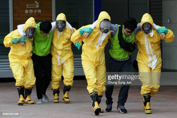 Emergency services personnel wearing protective clothing participate in an antiterror and antichemical terror exercise as part of the 2017 Ulchi...