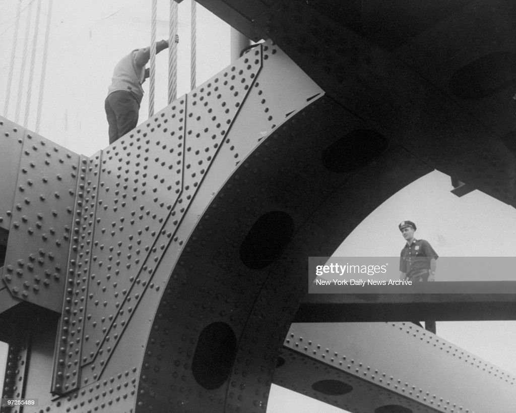 Emergency Services police officer climbs bridge to stop a potential suicide.