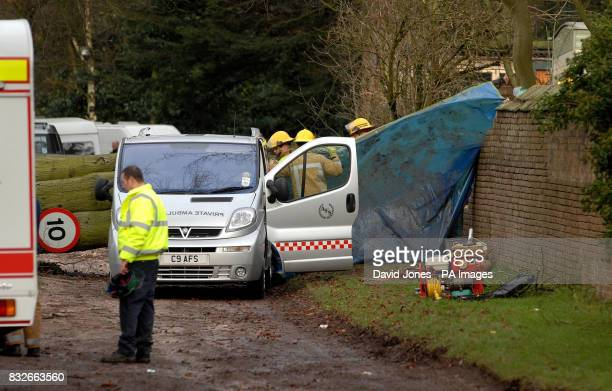Emergency services remove the body of an 18yearold woman who died during last night's storms when a tree fell onto a caravan at the Hales Hall...