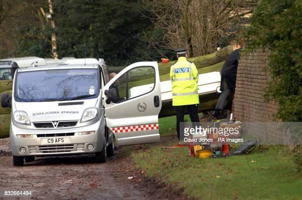Emergency services remove the coffin of an 18yearold woman who died during last night's storms when a tree fell onto a caravan at the Hales Hall...