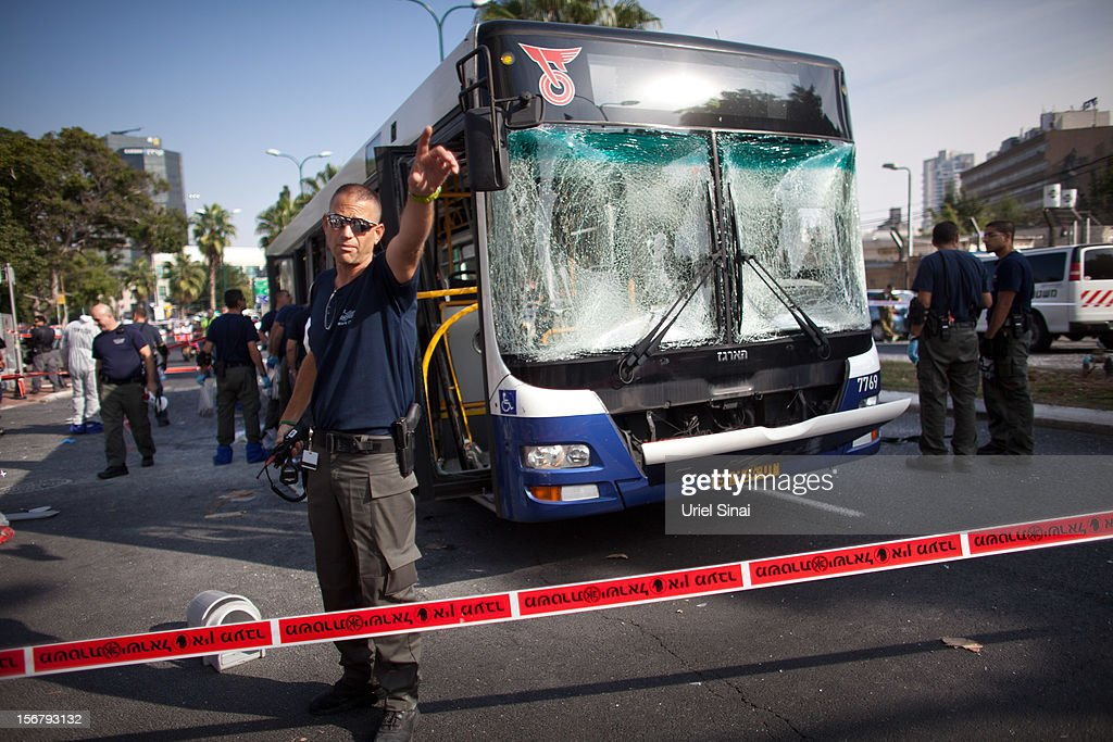 Emergency services respond to the scene of an explosion on a bus with passengers onboard on November 21, 2012 in central Tel Aviv, Israel. At least ten people have been injured in a blast on a bus near military headquarters in what is being described as terrorist attack, which threatens to derail ongoing cease-fire negotiations between Israeli and Palestinian authorities.