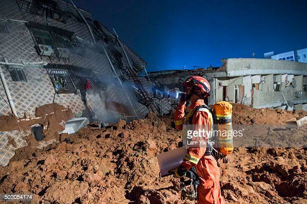 Emergency services search for survivors at an industrial park after a landslide buried 22 buildings on December 20 2015 in Shenzhen China Reports say...