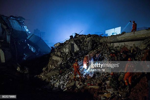 Emergency services search rubble for survivors after a landslide buried 22 buildings on December 20 2015 in Shenzhen China Reports say at least 27...