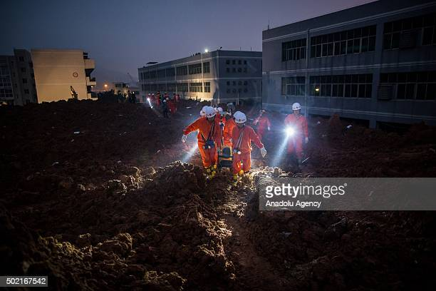 Emergency services search rubble for survivors after a landslide buried 22 buildings on December 20 2015 in Shenzhen China Chinese teams continued...