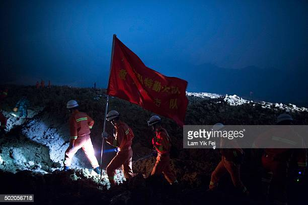 Emergency services search the area after a landslide buried 22 buildings on December 20 2015 in Shenzhen China Reports say at least 27 people are...