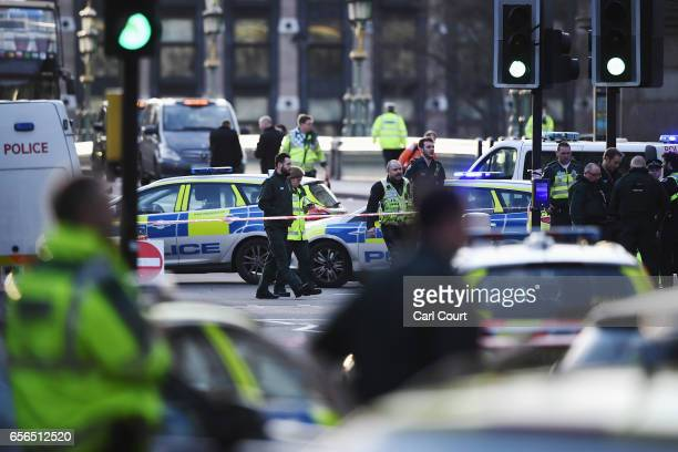 Emergency services vehicles seen on Westminster Bridge on March 22 2017 in London England A police officer was stabbed near to the British Parliament...