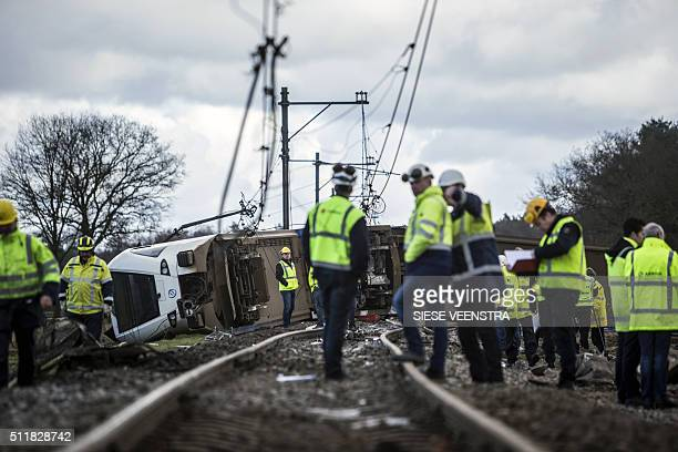 TOPSHOT Emergency services work at a derailed passengers train near Dalfsen eastern Netherlands on February 23 2016 A passenger train collided with a...