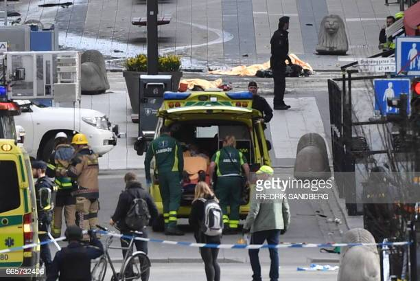 Emergency services work at the scene where a truck crashed into the Ahlens department store at Drottninggatan in central Stockholm April 7 2017 News...