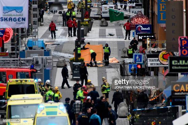 TOPSHOT Emergency services work at the scene where a truck crashed into the Ahlens department store at Drottninggatan in central Stockholm April 7...