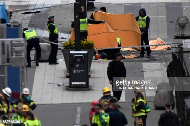 Emergency services work at the scene where a truck crashed into the Ahlens department store at Drottninggatan in central Stockholm April 7 2017 PHOTO...