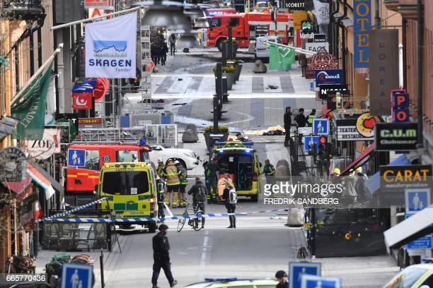 Emergency services work at the scene where a truck crashed into the Ahlens department store at Drottninggatan in central Stockholm April 7 2017 A...