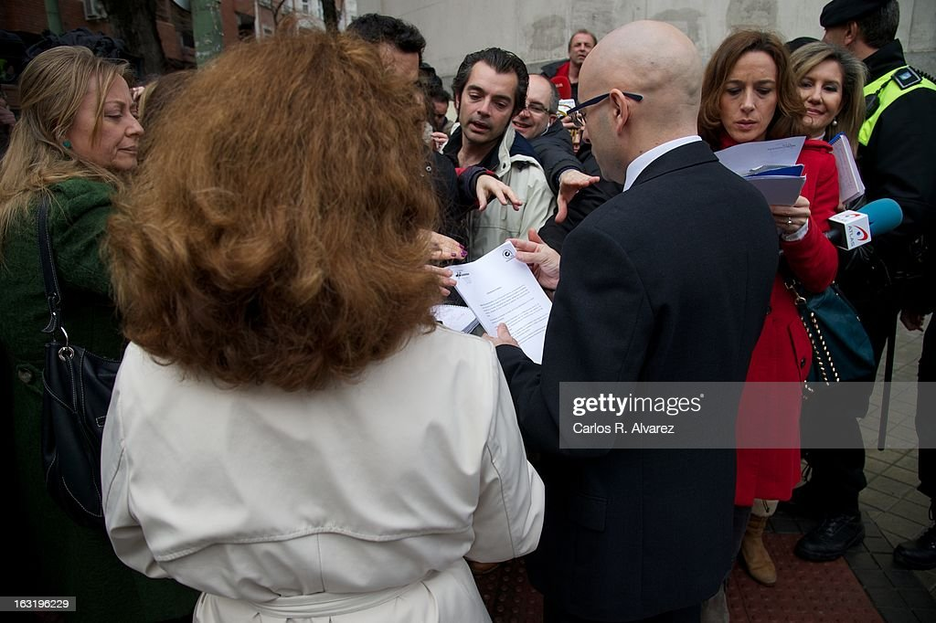 Emergency services worker provides a official document to inform about the fire produced this morning at the La Milagrosa clinic, where King Juan Carlos is recovering from a hernia operation, on March 6, 2013 in Madrid. Five people were injured in the blaze that resulted from an oxygen tank explosion which was stored on the ground floor of the center.